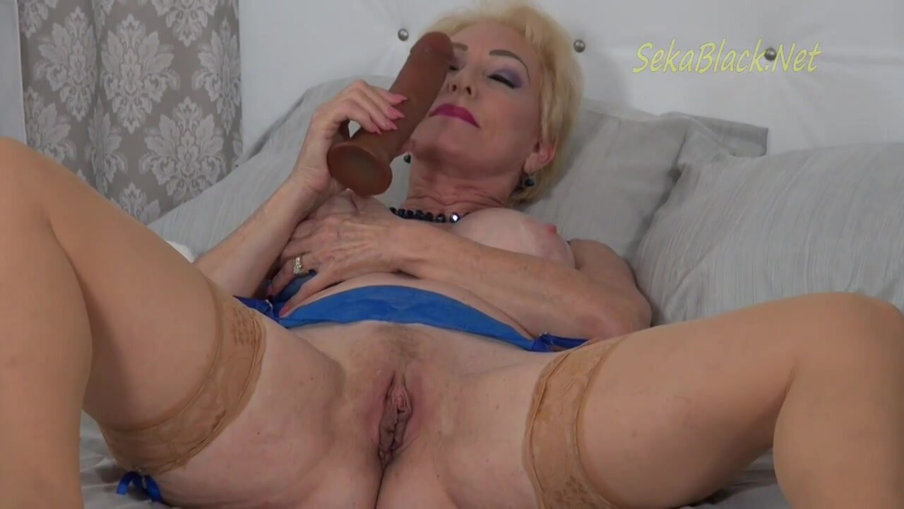 Horny blonde granny, Seka is wearing erotic, blue lingerie while toying her perfectly shaved pussy