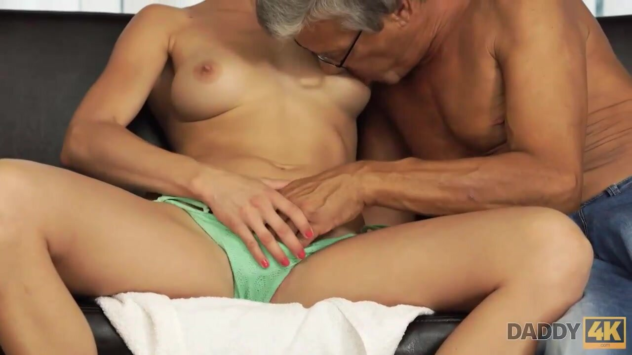 Horny chick is about to have casual sex with her boyfriend's father, on the couch