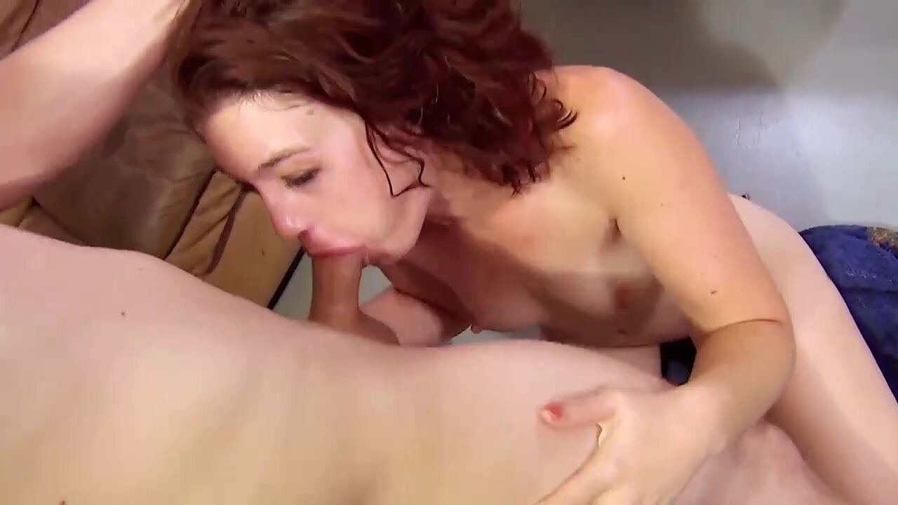Red haired babe is sucking her lover's dick as deep as she can to get a facial