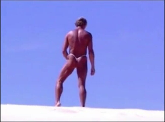 Tanned guy on beach in tiny string thong (temporarily!) 6