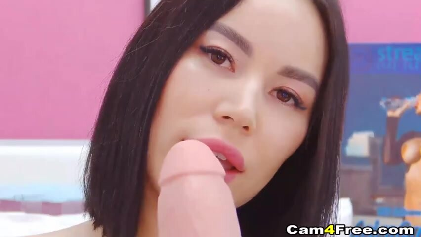 Horny brunette with big boobs is spreading her legs wide open while masturbating on cam